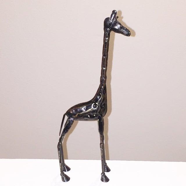 Image of Tall Metal Giraffe Sculpture