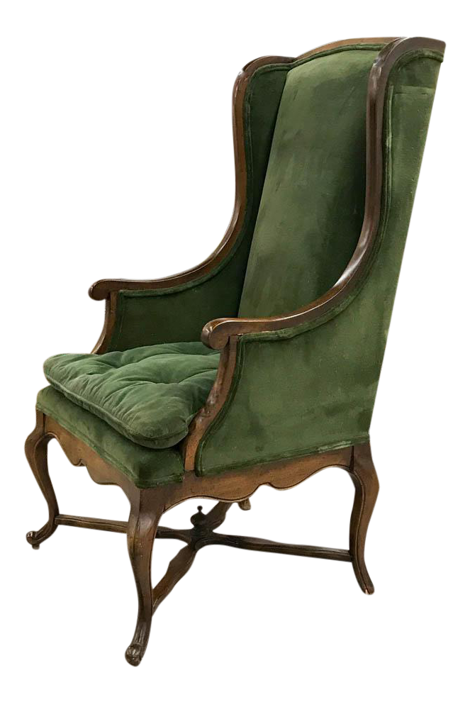 mid century wingback chair in green velvet