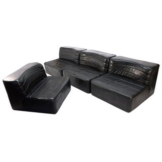 Four Piece Black Leather Sectional Set