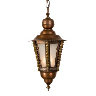 A charming brass and copper hall lantern from France c. 1920 having panes of frosted glass.