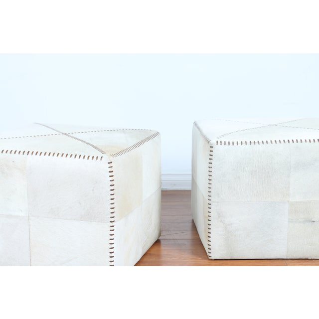 Image of Leather Stitched Cowhide Ottomans - A Pair