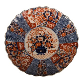 A large Imari platter with a scalloped rim imported from Japan c. 1885 into France