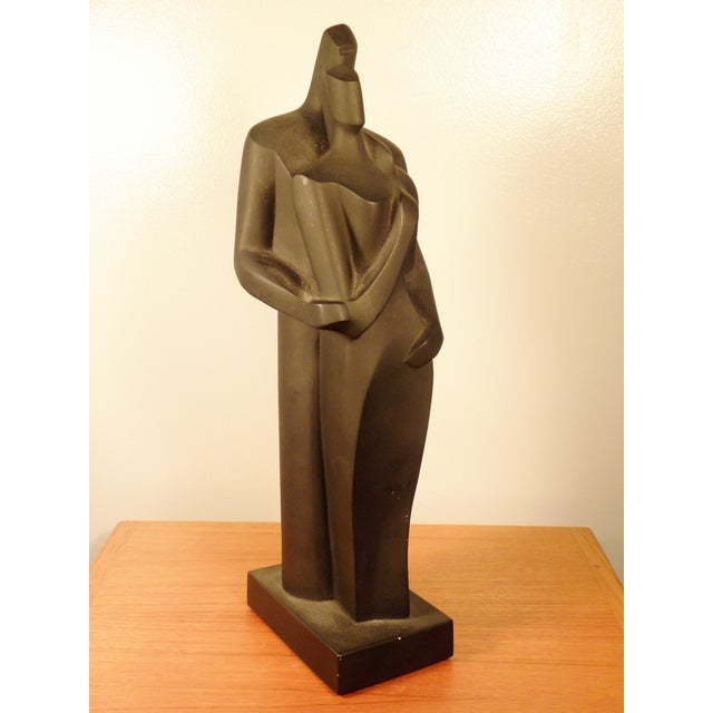 Image of Modern Sculpture Embracing Man and Woman