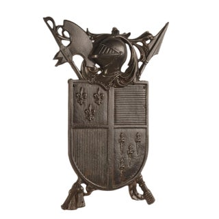 A solid cast iron plaque from France c. 1885 featuring an homage to the age of chivalry and bravery in battle