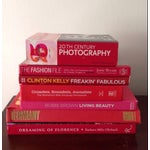 Image of Stack of Glossy Red Books