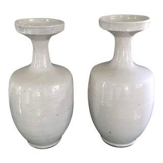 Tall Glazed White Ceramic Urns - A Pair