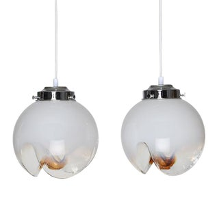 PAIR OF MAZZEGA WHITE, CLEAR AND ORANGE GLASS PENDANTS