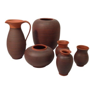 Set of orange striped pottery by Maria Laach