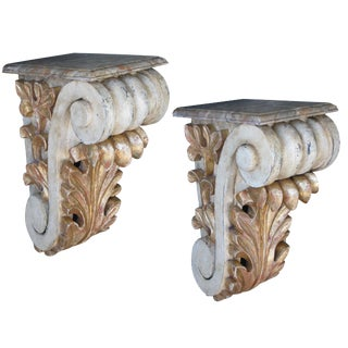 A Dramatic and Large-Scaled Pair of American Classical-Revival Ivory Painted and Parcel-Gilt Wooden Corbels