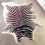 Image of Zebra Stenciled Black Ivory Hide Rug - 6'10 X 5'7