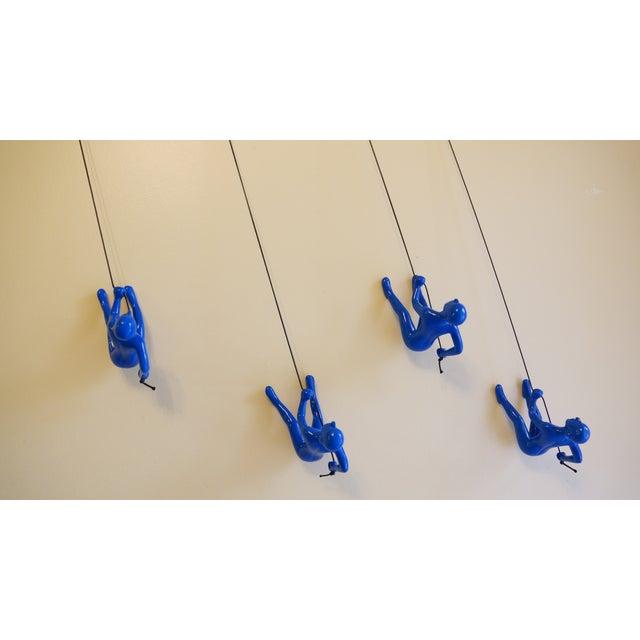 Image of Blue Position 2 Climbing Man Wall Art - Set of 4