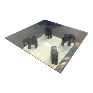Glass Coffee Table With Wooden Elephant Stands