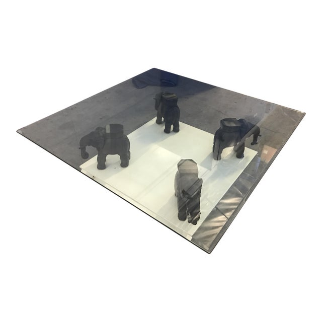 Glass Coffee Table With Wooden Elephant Stands - Image 1 of 8