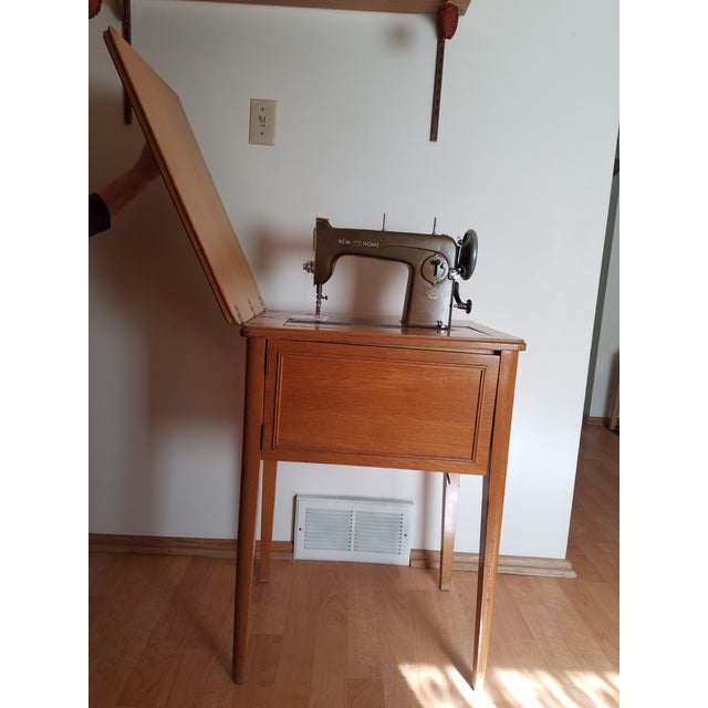Image of Mid-Century New Home Sewing Machine With Cabinet