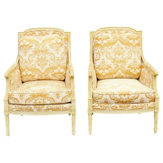 Louis XV Style Distressed Cream Painted Carved Bergeres - A Pair