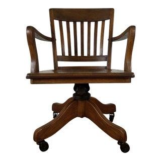 Vintage Wheeled Banker's Armchair