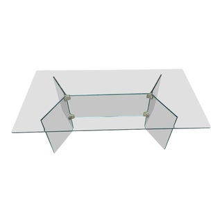 Pace glass coffee table with brass brackets