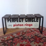Image of Vintage Piston Rings Sign Industrial Bench