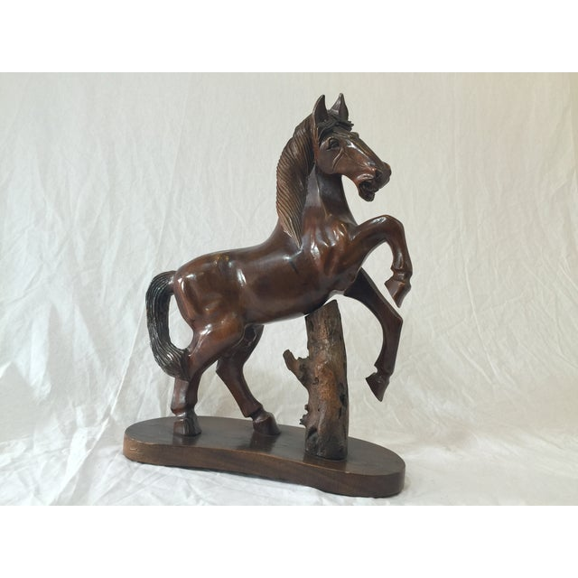 Image of Carved Wooden Horse on Wood Stand