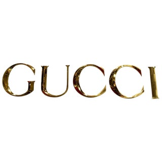 "Brass Letters Spelling ""GUCCI"""