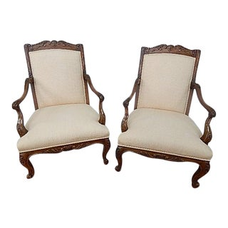 A Pair of Baker Furniture French Style Carved Arm Chairs