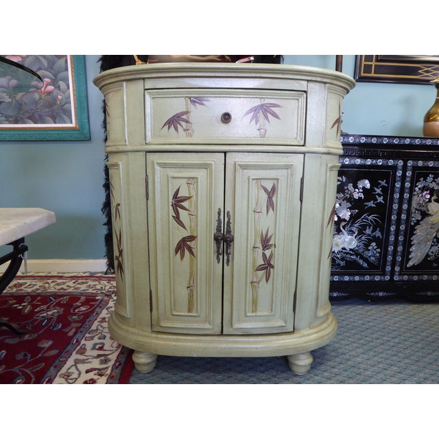 Image of Tropical Oval Storage Cabinet Side Table