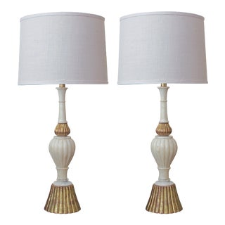 A shapely pair of Italian 1960's baluster-form carrara marble lamps with gilt-wood mounts