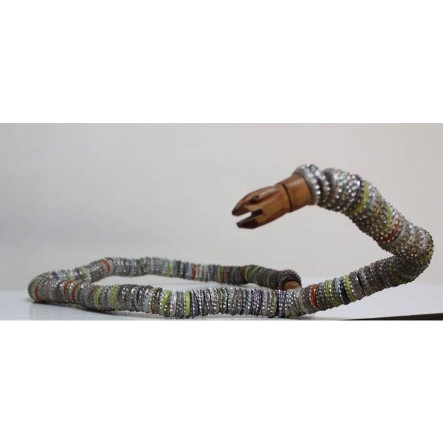 Image of Folk Art Carved Wood and Bottlecap Snake after Felipe Archuleta