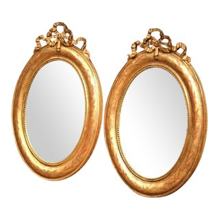 18th Century French Louis XVI Oval Gilt Ribbon Bow Mirrors - a Pair