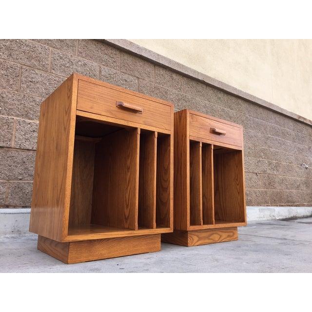 Image of Mid Century Oak Nightstands With Vinyl Storage - 2