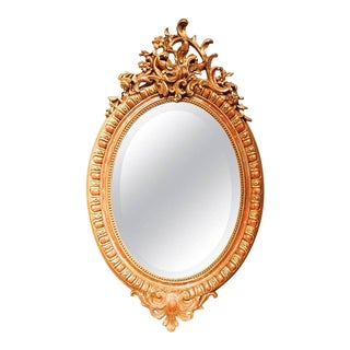 19th Century Oval French Gilded Rococo Crested Mirror
