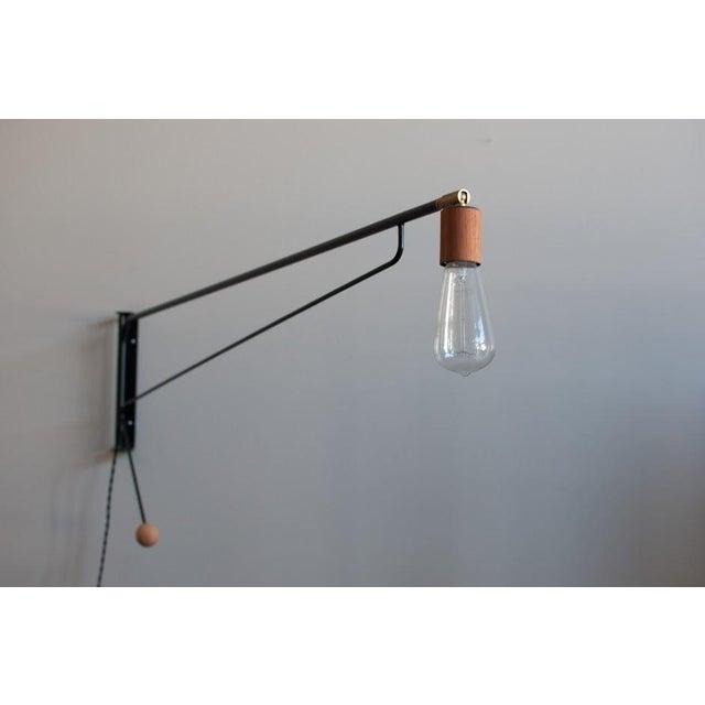 Image of Wall-Mounted Swing Light