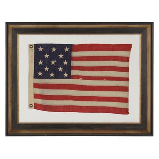 13 STARS ARRANGED IN A 3-2-3-2-3 LINEAL CONFIGURATION ON AN TINY ANTIQUE AMERICAN FLAG