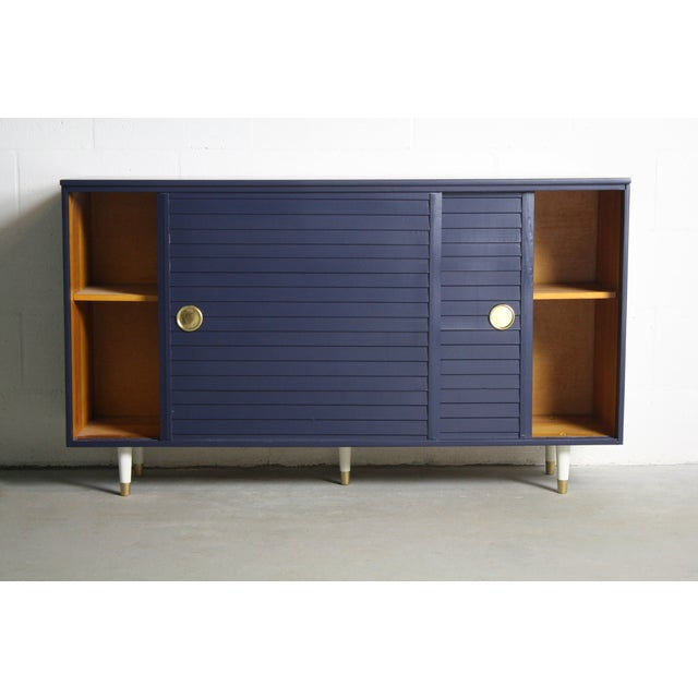 Image of 1960's Navy Cabinet W/ White & Gold Tapered Legs