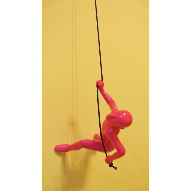Image of Pink Climbing Man Wall Art