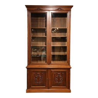 Tall Early 20th Century French Carved Walnut Bookcase With Beveled Glass Doors