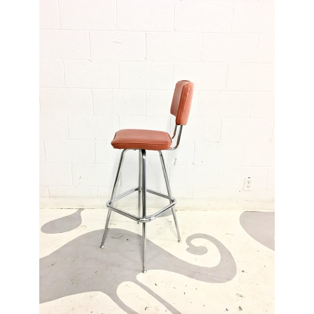 Image of Mid-Century Chrome and Orange Vinyl Barstool