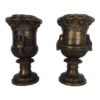 A Pair of French Patinated Bronze Urns With Rums Head Decoration