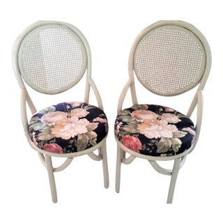 Mid-Century Rattan and Cane-Backed Chairs With Vibrant Floral Cushioned Seating - A Pair