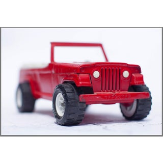 Red Jeep Facing Front Photograph