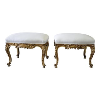 Early 20th Century Giltwood White Linen Upholstered Ottomans - a Pair