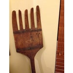 Image of Antique Tall Wooden Fork Banded With Metal