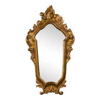 A Louis XV/Regence style gilded frame from the Belle Epoque period in France c.1890 enclosing the original mirror glass (15″w x 27″h)