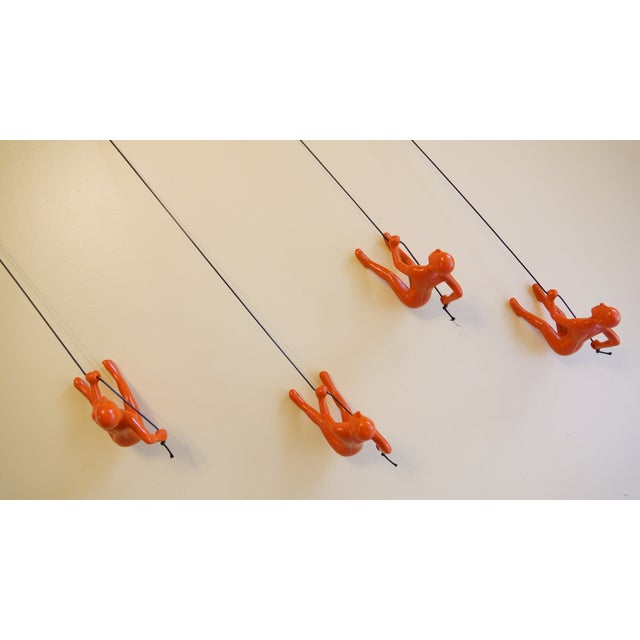 Image of Orange Position 2 Climbing Man Wall Art - Set of 4