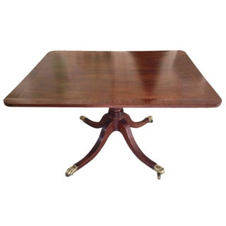 English Georgian Tilt-Top Mahogany Supper Table with Brass Lion's Paw Feet