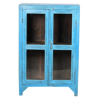 Sky Blue Glass Paneled Cabinet