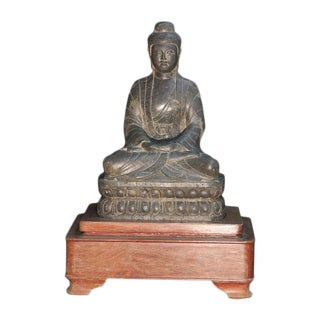 Seated​ ​Stone​ ​Buddha​ ​in​ ​Wooden​ ​Base