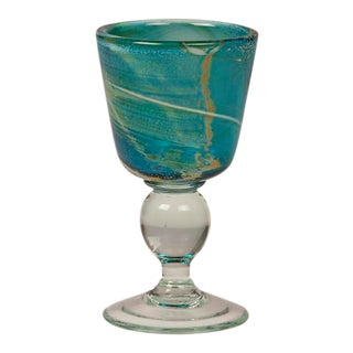A small circular goblet featuring the enchanting turquoise color of hand blown Mdina glass from Malta c. 1975