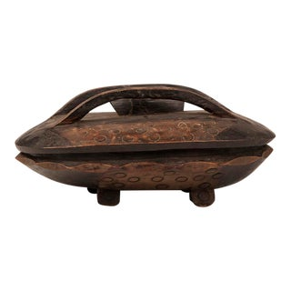 A Zambian food bowl hand carved and decorated from native timber with a interior divided food compartment and the original top from Africa c.1900