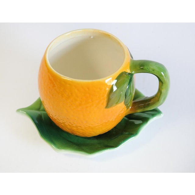 Image of Majolica Orange Cup and Leaf Saucer